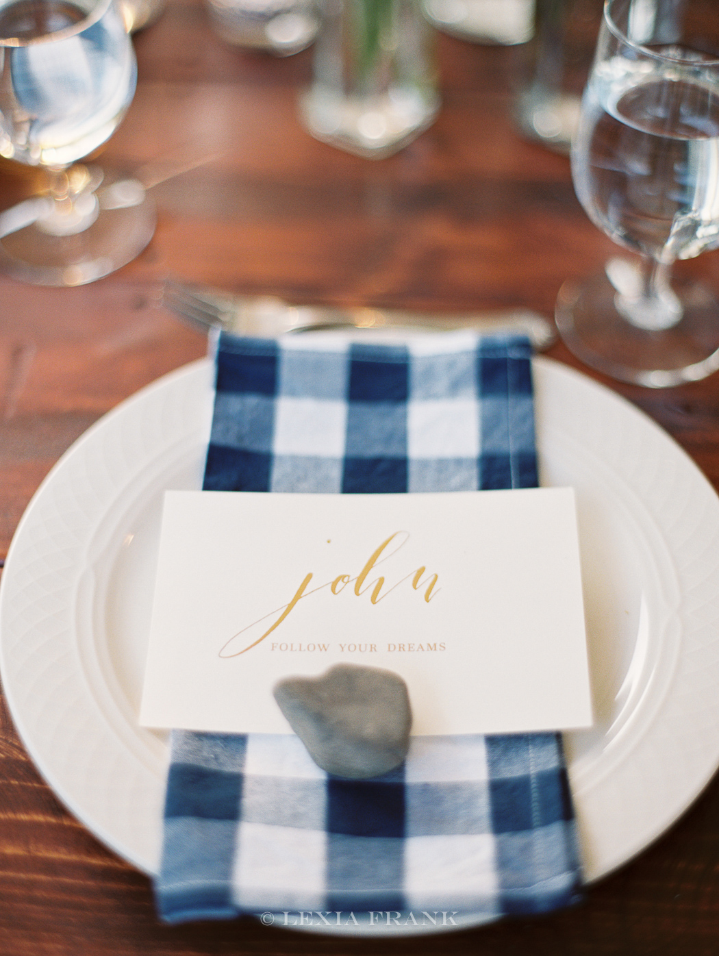 Destination Wedding Photographer Lexia Frank - a portland oregon fine art film photographer- photographed this wedding at camp wandawega in wisconsin for Camp Wedding by Cherry Blossom Events  www.lexiafrank.com plaid napkin, gold calligraphy, rock placecard, formal picnick, gourmet luncheon ideas  Image  EDIT  REMOVE