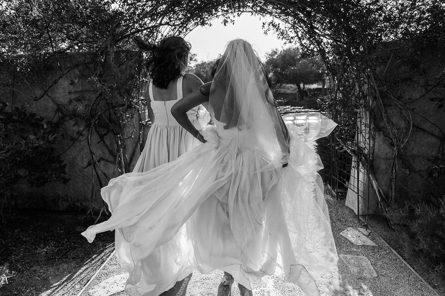 Destination wedding photographer Lexia Frank is a portland oregon fine art wedding photographer. bride walks through the entrance at her sunstone winery wedding in california. www.lexiafrank.com