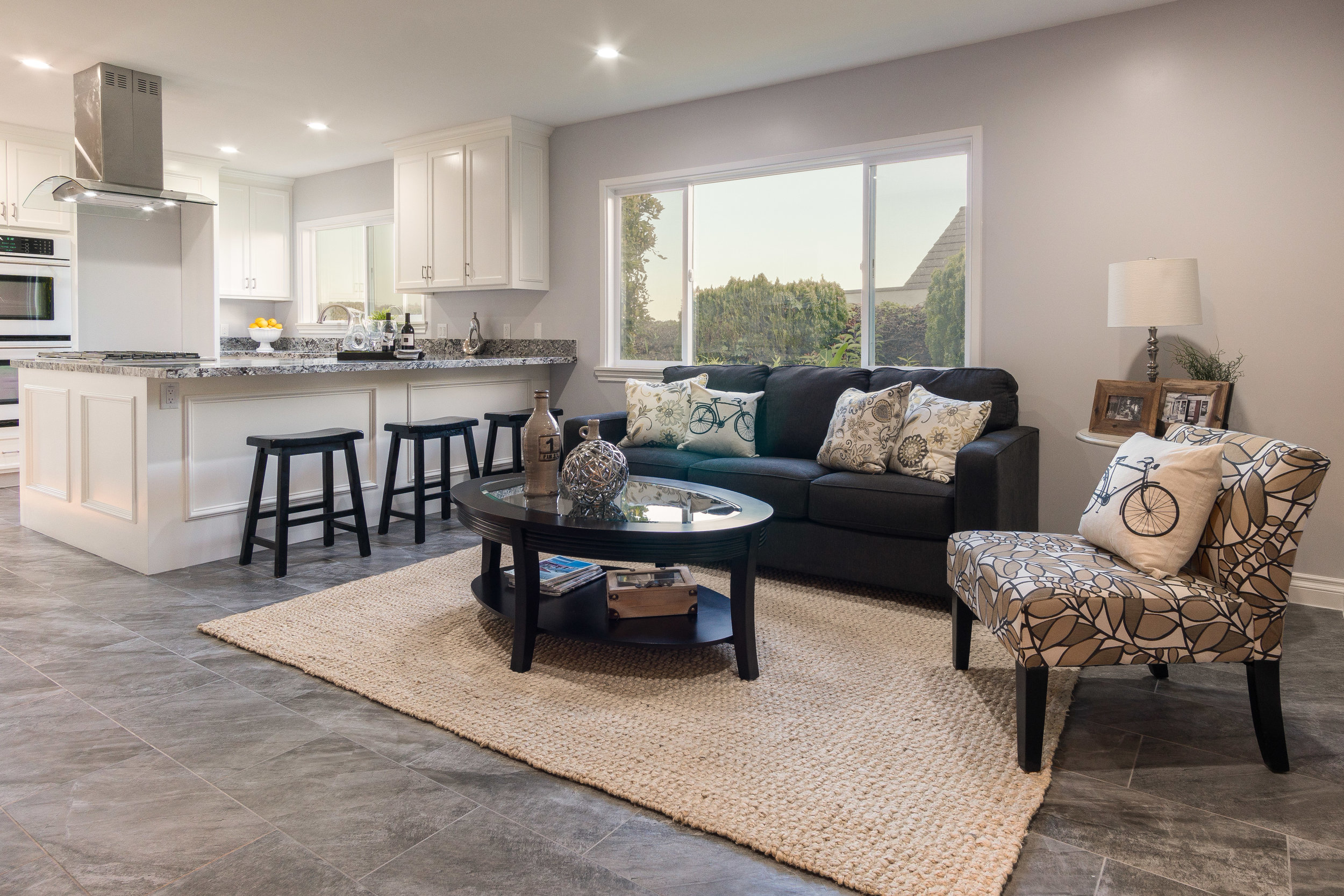 Delivered photo of the kitchen and sitting area ©Ryan Carr - Legacy Listing Photography - 2017