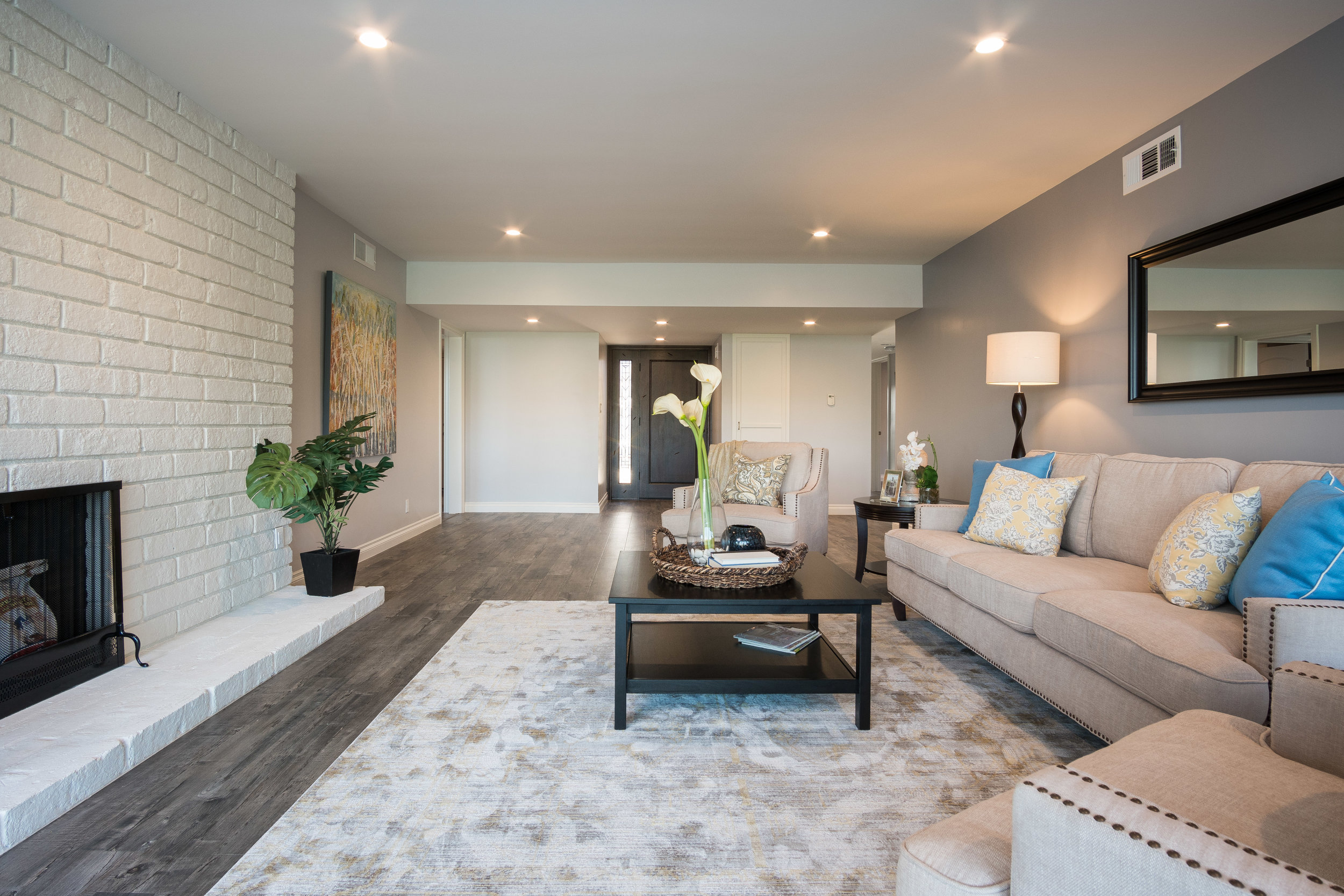 Delivered photo of the entryway and living room ©Ryan Carr - Legacy Listing Photography - 2017