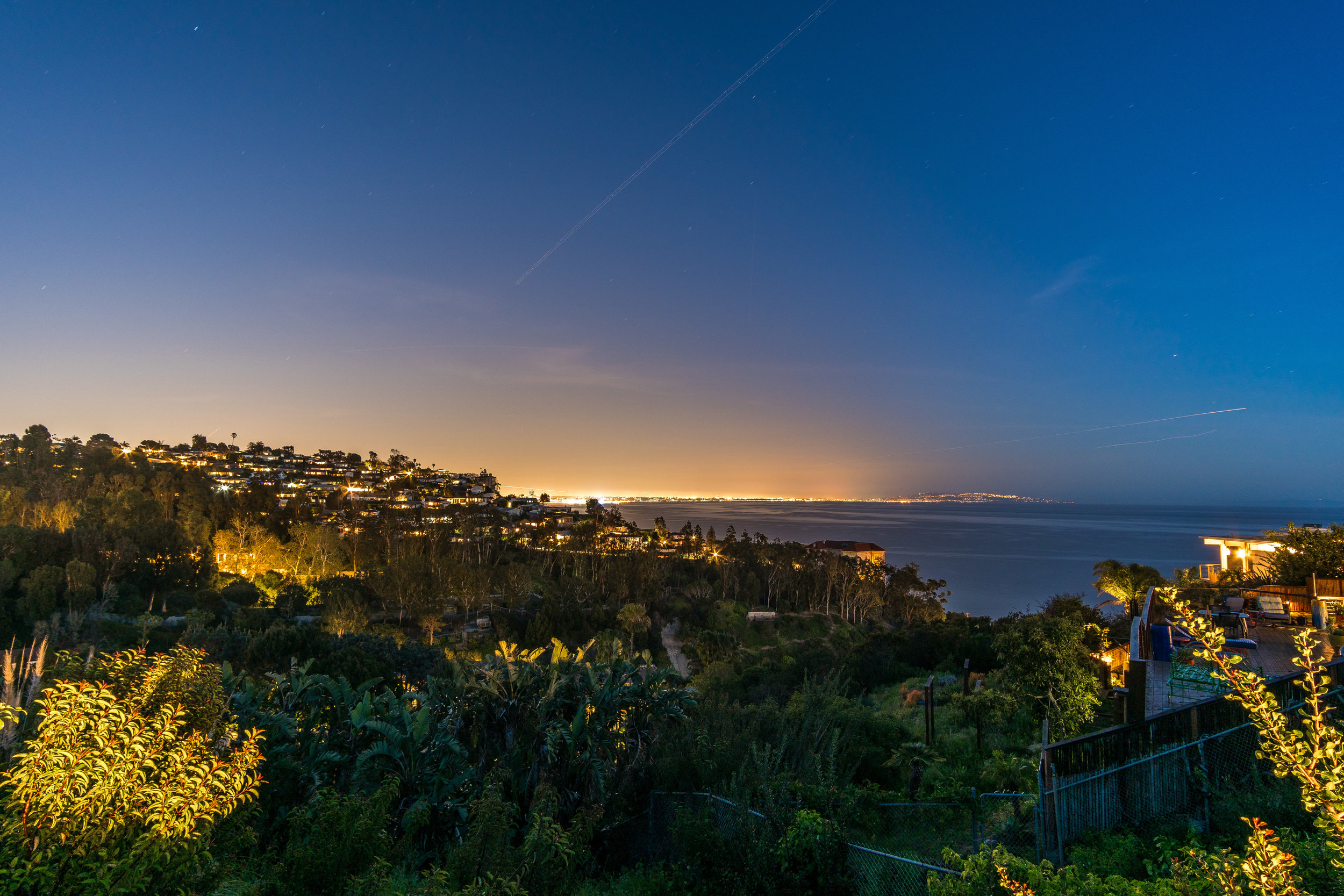 Delivered twilight photo of the view of Malibu and Malibu Beach ©Ryan Carr - Legacy Listing Photography - 2017