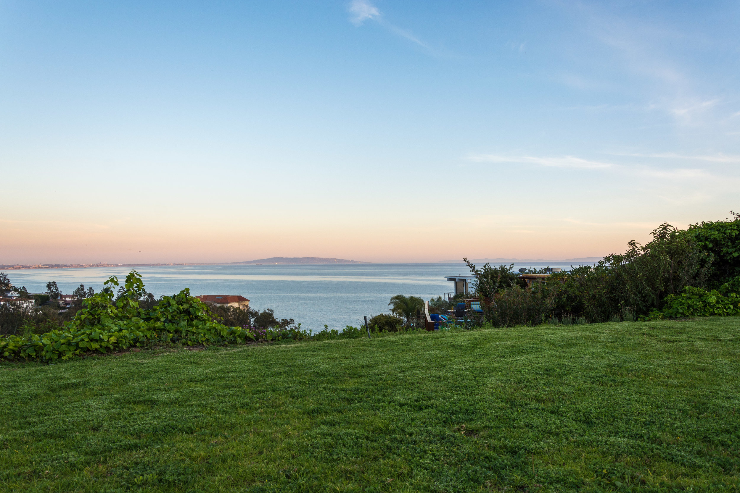 Delivered photo of the view of Malibu Beach from the backyard ©Ryan Carr - Legacy Listing Photography - 2017