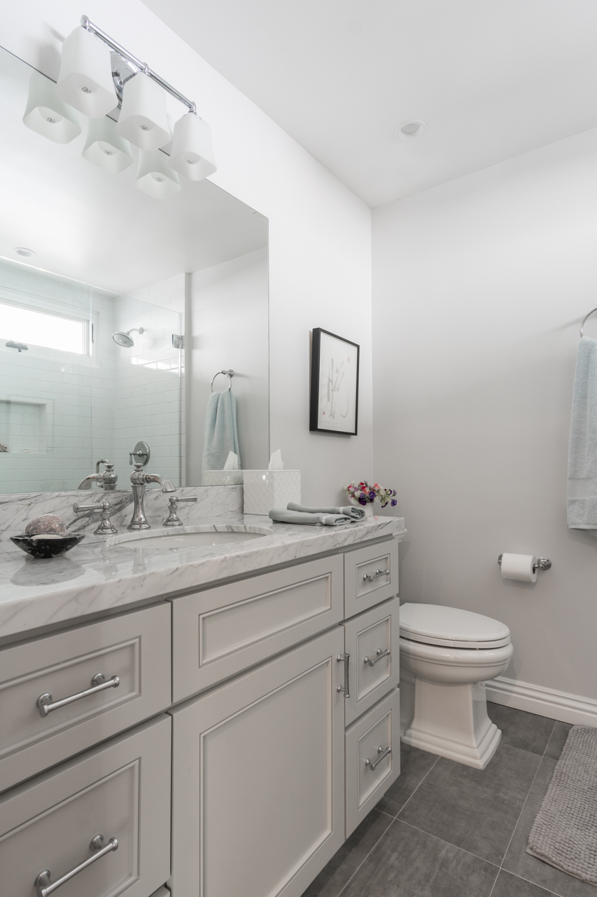 Delivered photo of the guest bathroom ©Ryan Carr - Legacy Listing Photography - 2017