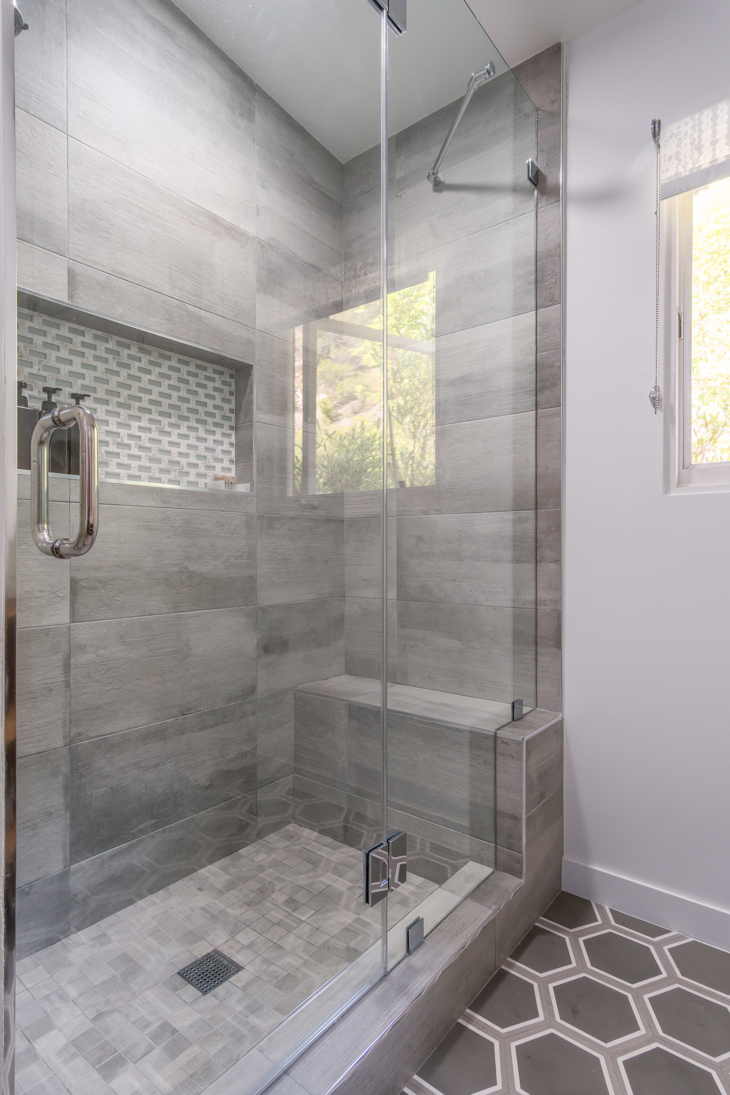 Delivered photo of the showe in this bathroom remodel ©Ryan Carr - Legacy Listing Photography - 2017