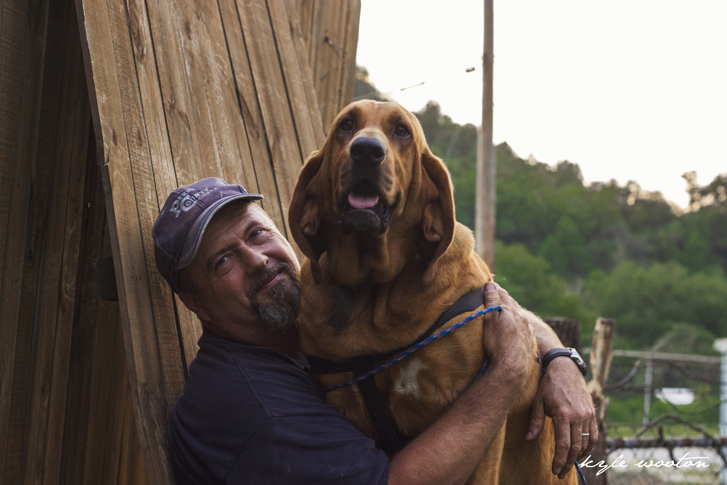 A coal miner at home, enjoying the day off with his bloodhound Sadie Bell. Photo by: Kyle Wooton
