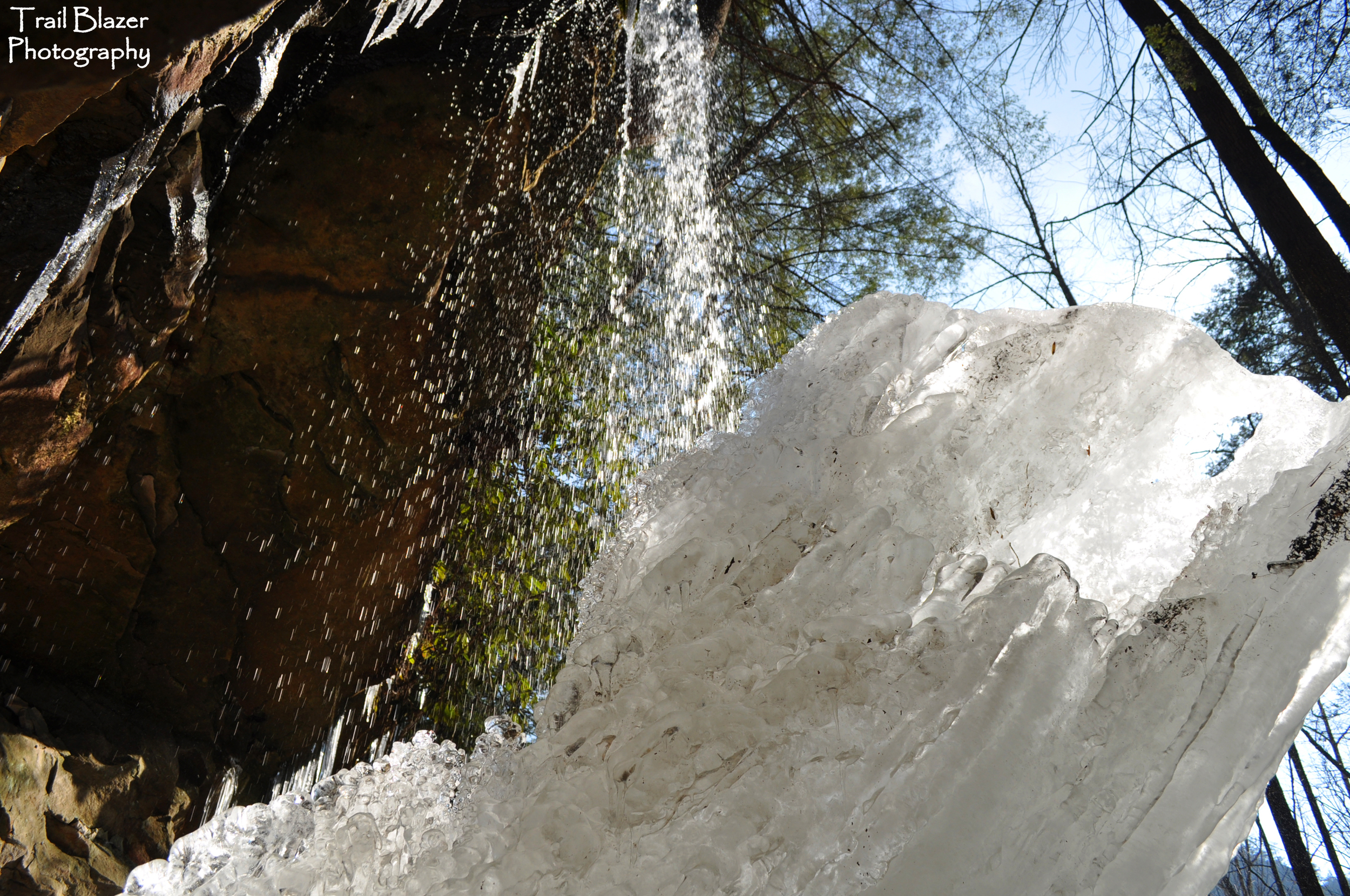 Behind a partly frozen Angel Falls.