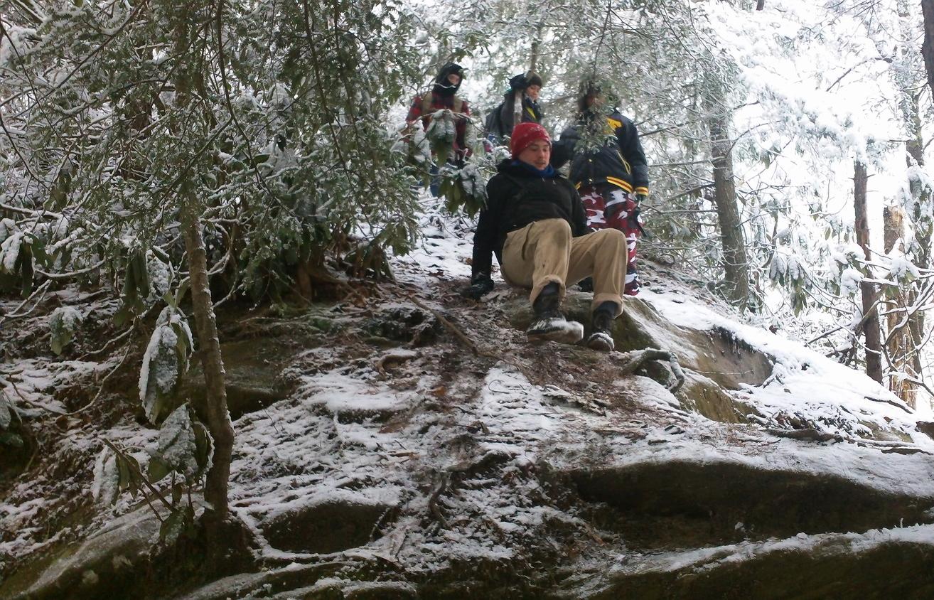Field team negotiating an icy ridge.