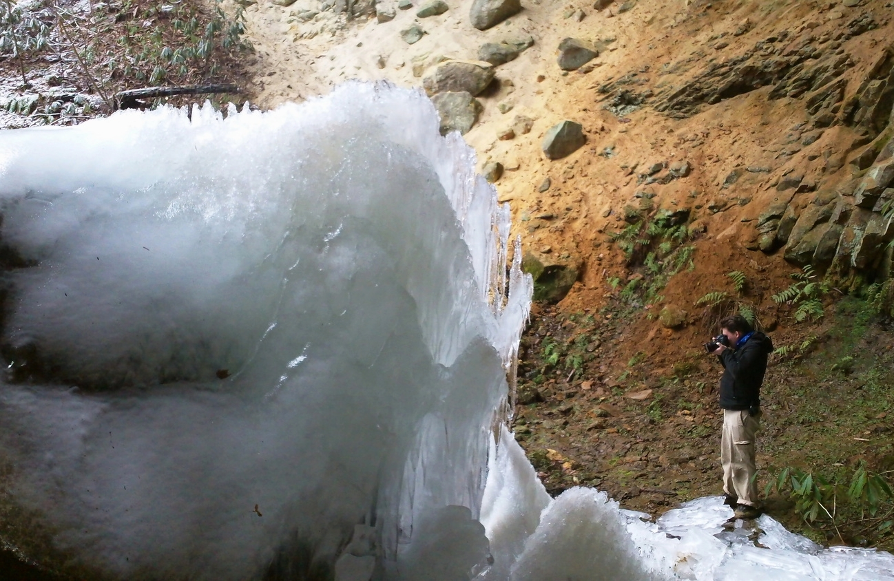 Videographer Nate Spicer catching the falling water.  Photo via Gerry James