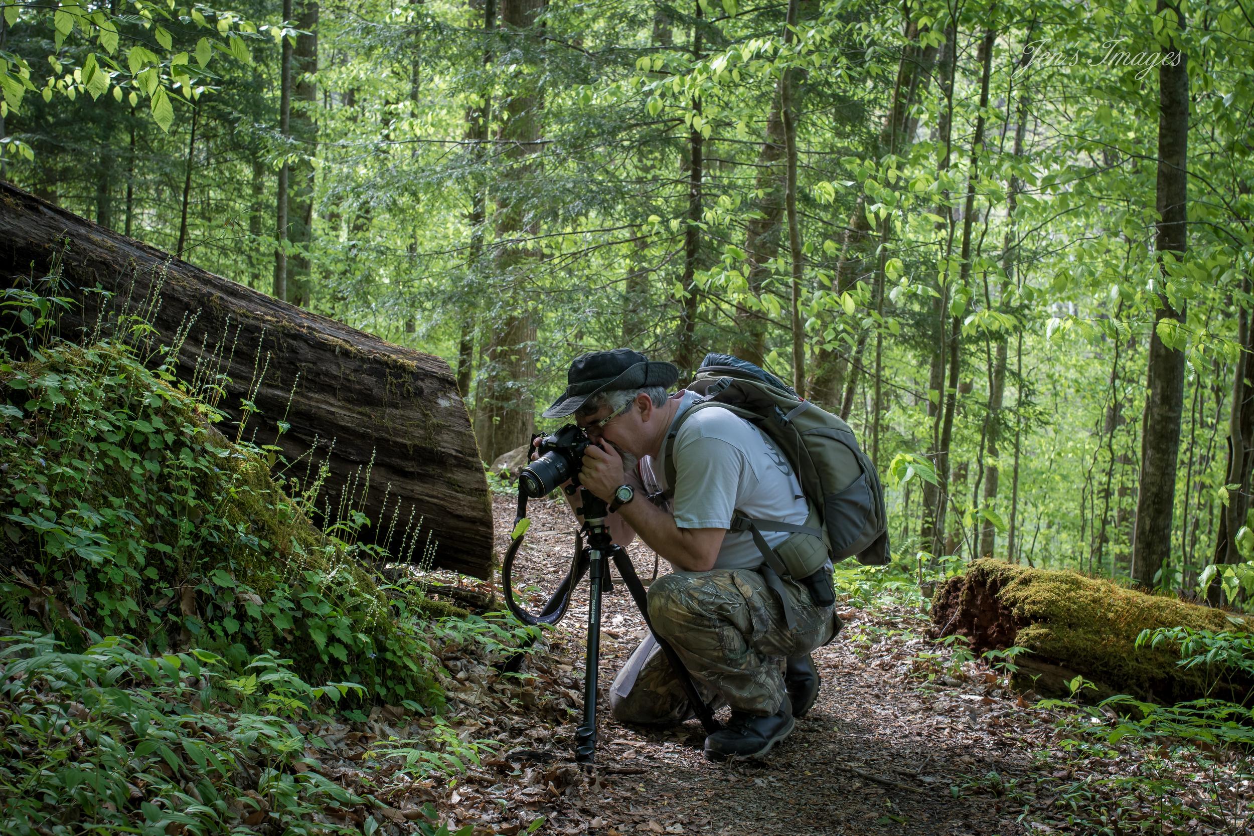 Jenny Davis' photo of husband Greg photographing wildflowers at Yahoo Falls.