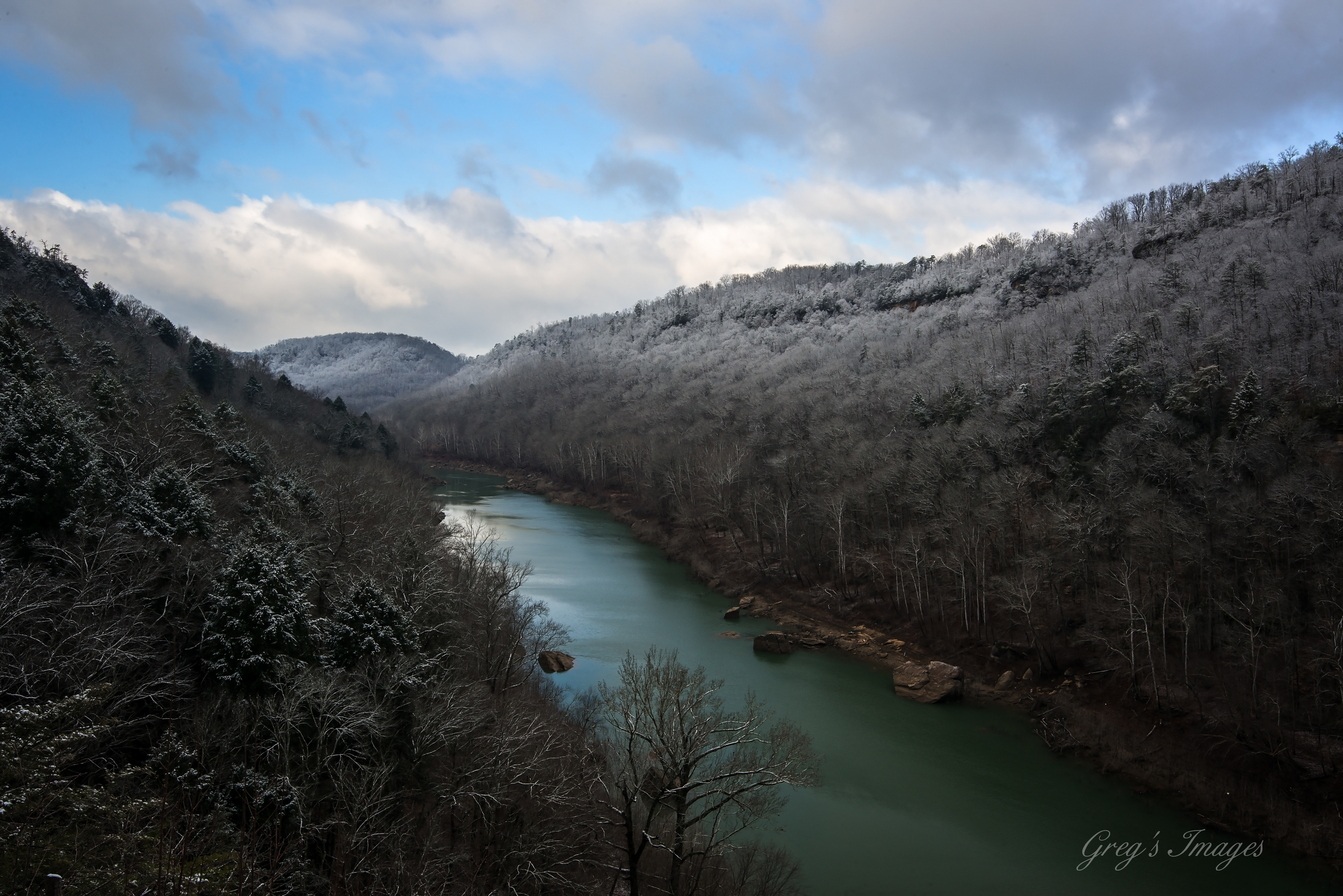 Snow-capped ridges along the South Fork River as seen from Yahoo Overlook.