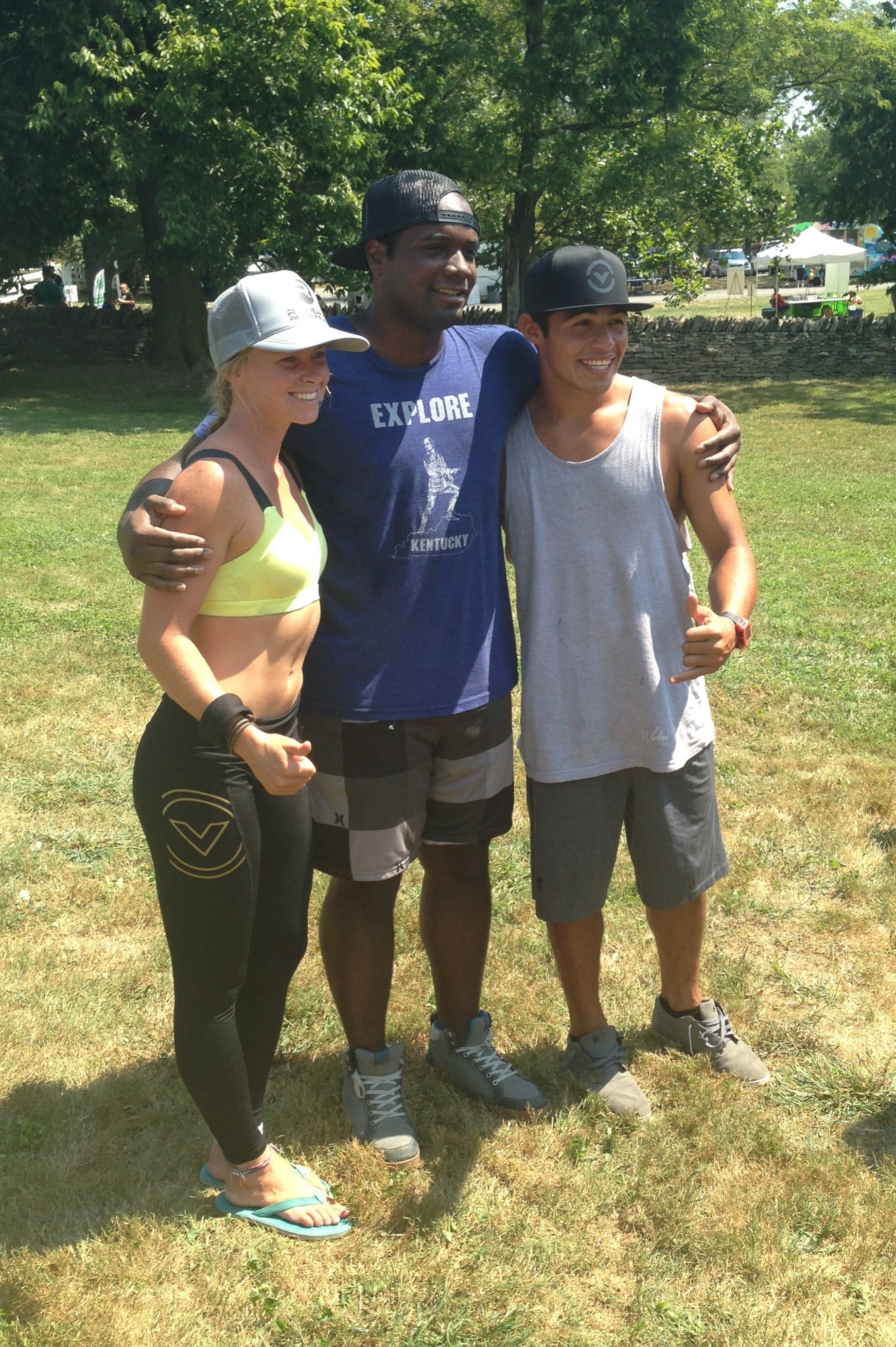 Forsake clad/ posing after the grueling Bluegrass SUP Derby race with Shelby Taylor and Bicho Jimenez, two of the world's top ranked paddlers.