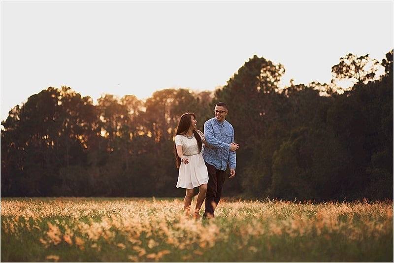 clermont engagment photographer engagement in a field (4).jpg