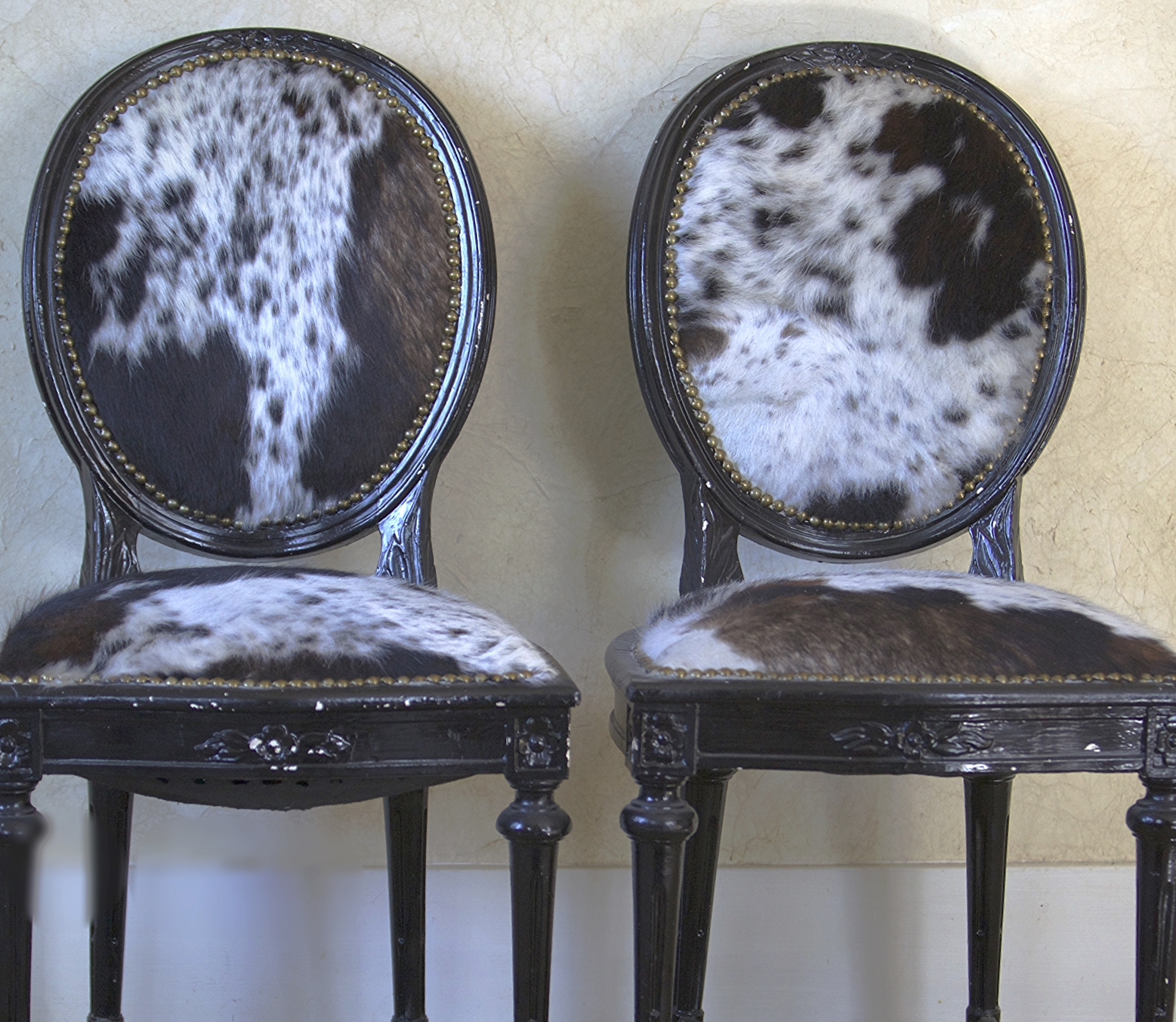Vintage Cowhide Chairs $75