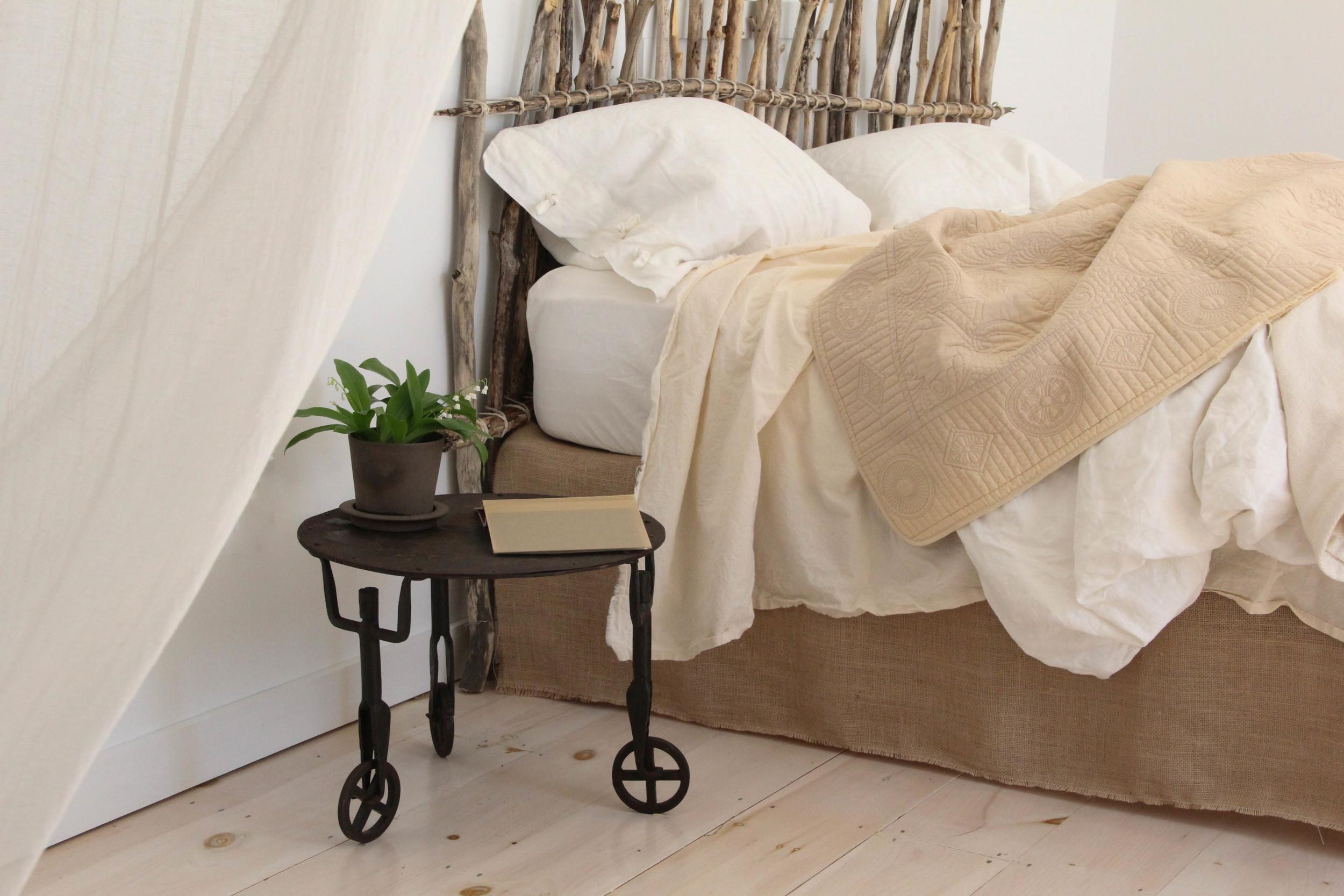 simple bedroom with twig headboard