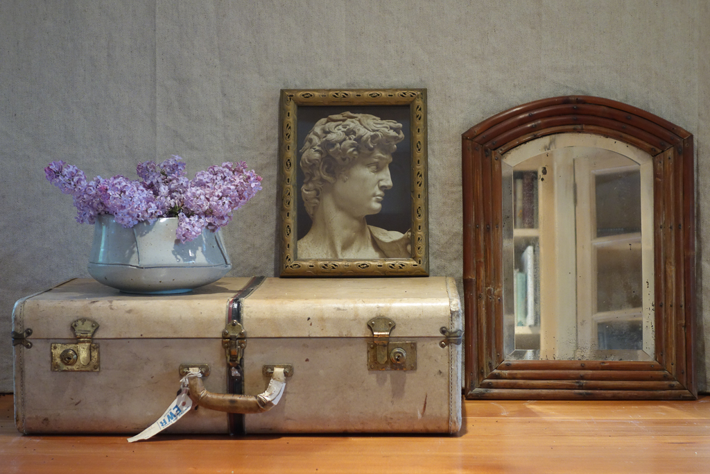 still life with suitcase and lilacs