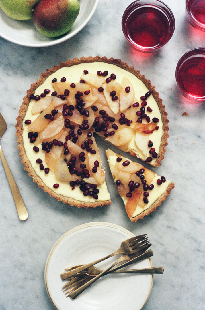 hazelnut cheesecake tart with pears and pomegranate | apt 2b baking co