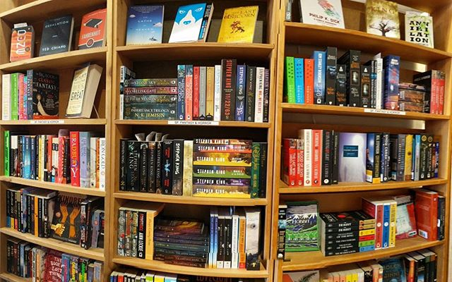 This summer we expanded our sci-fi, fantasy, and horror section to two full bookcases, well now it's three! What book is a must have for this section?
