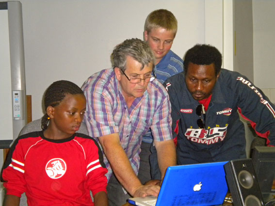 Kenneth, Danny, Mark and Derrick fine tuning the Mac for Garageband Demo (Photo C. Street)