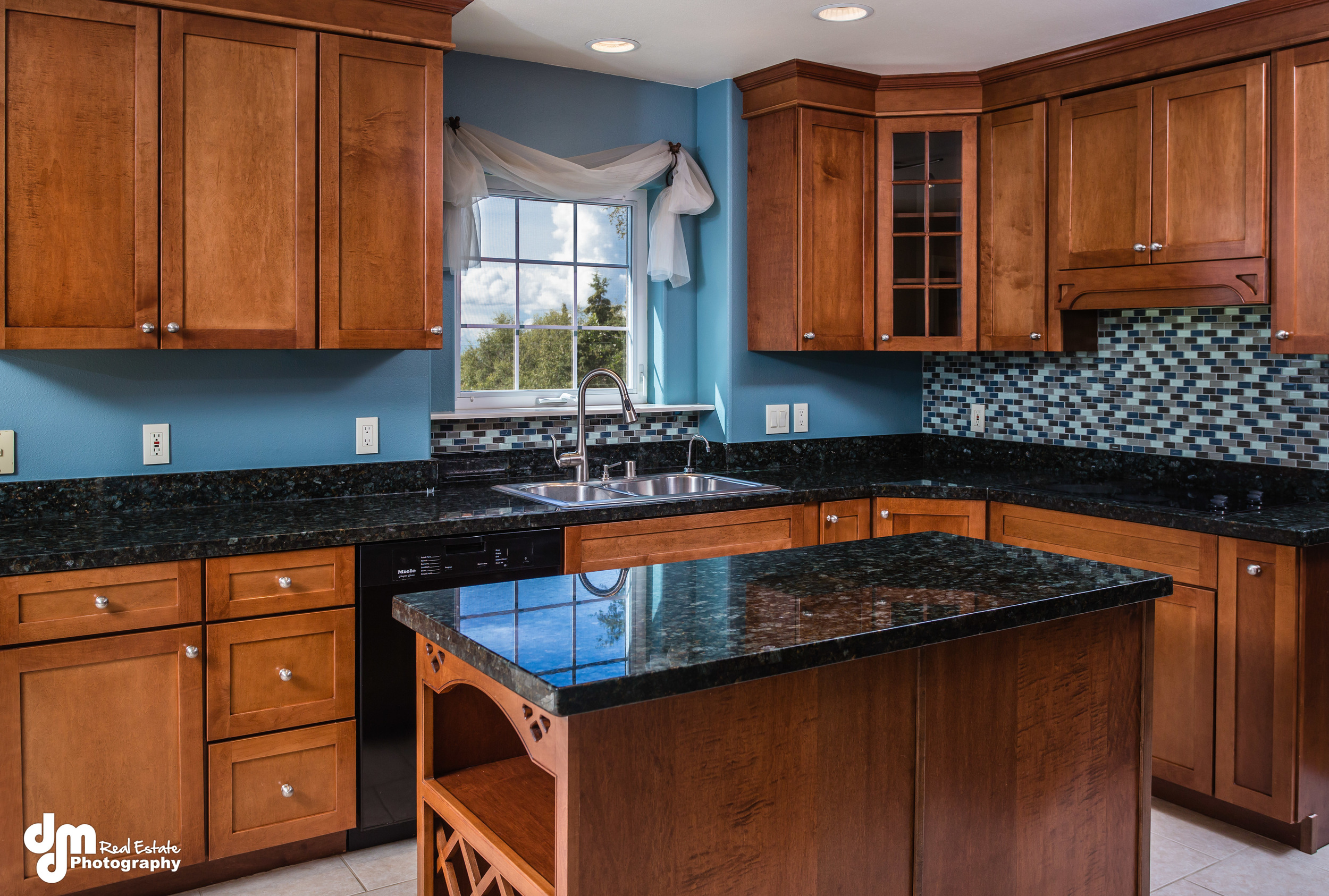 Dark cabinets, paint and countertops require a lot of light.  We used about 4 lights for this one shot.