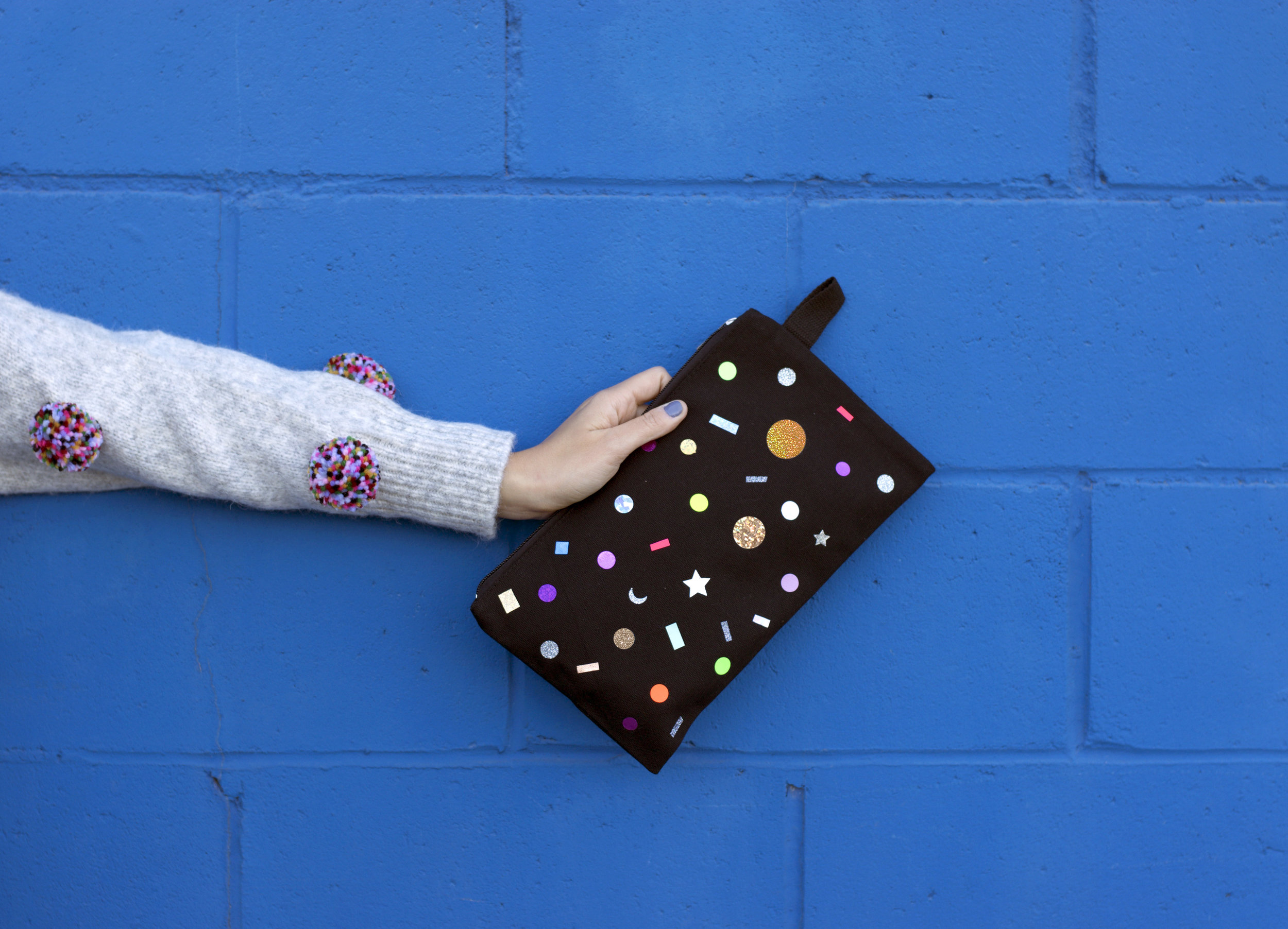 blue wall pouch and poms.jpg