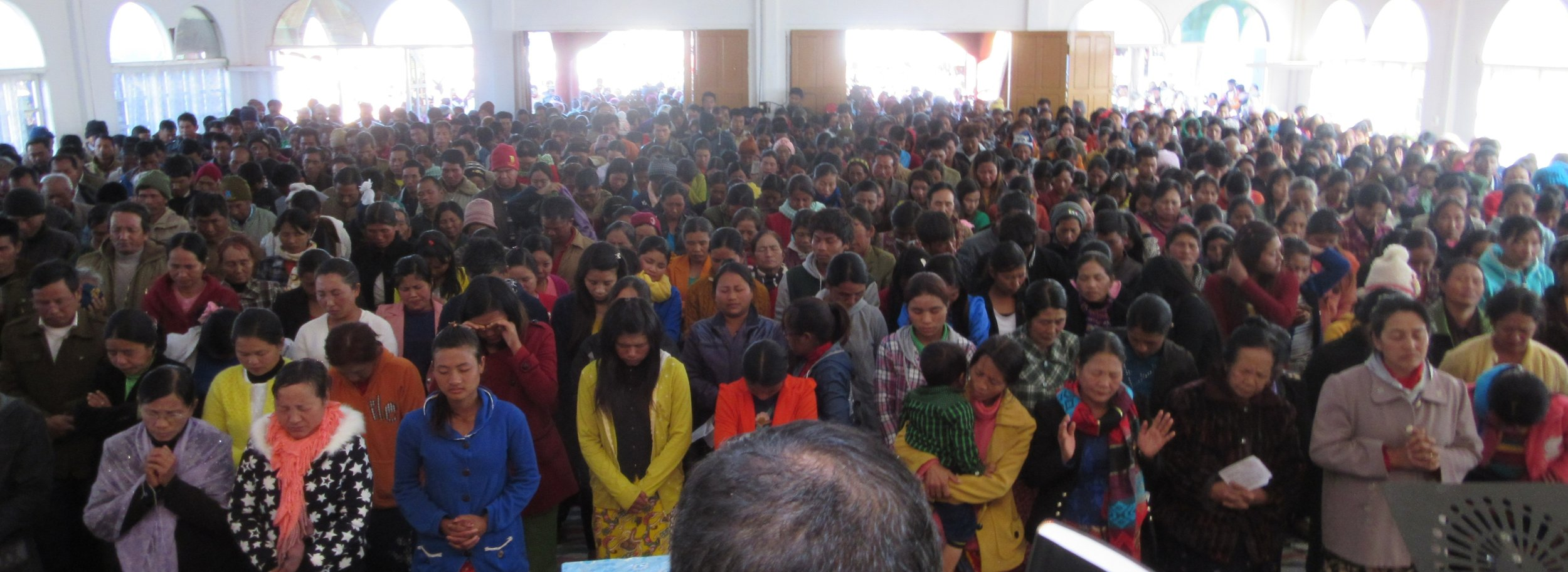 Photo: Chin Christians wait to receive their Bibles.