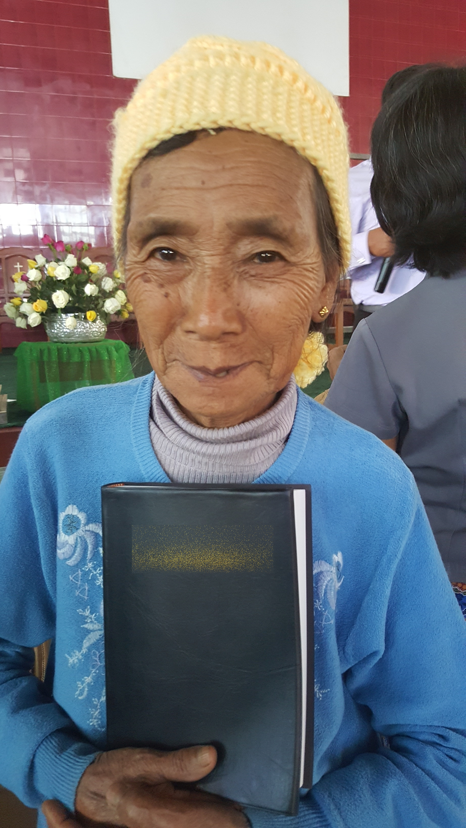 Photo: Chin woman with her new Bible, Chin state Myanmar.