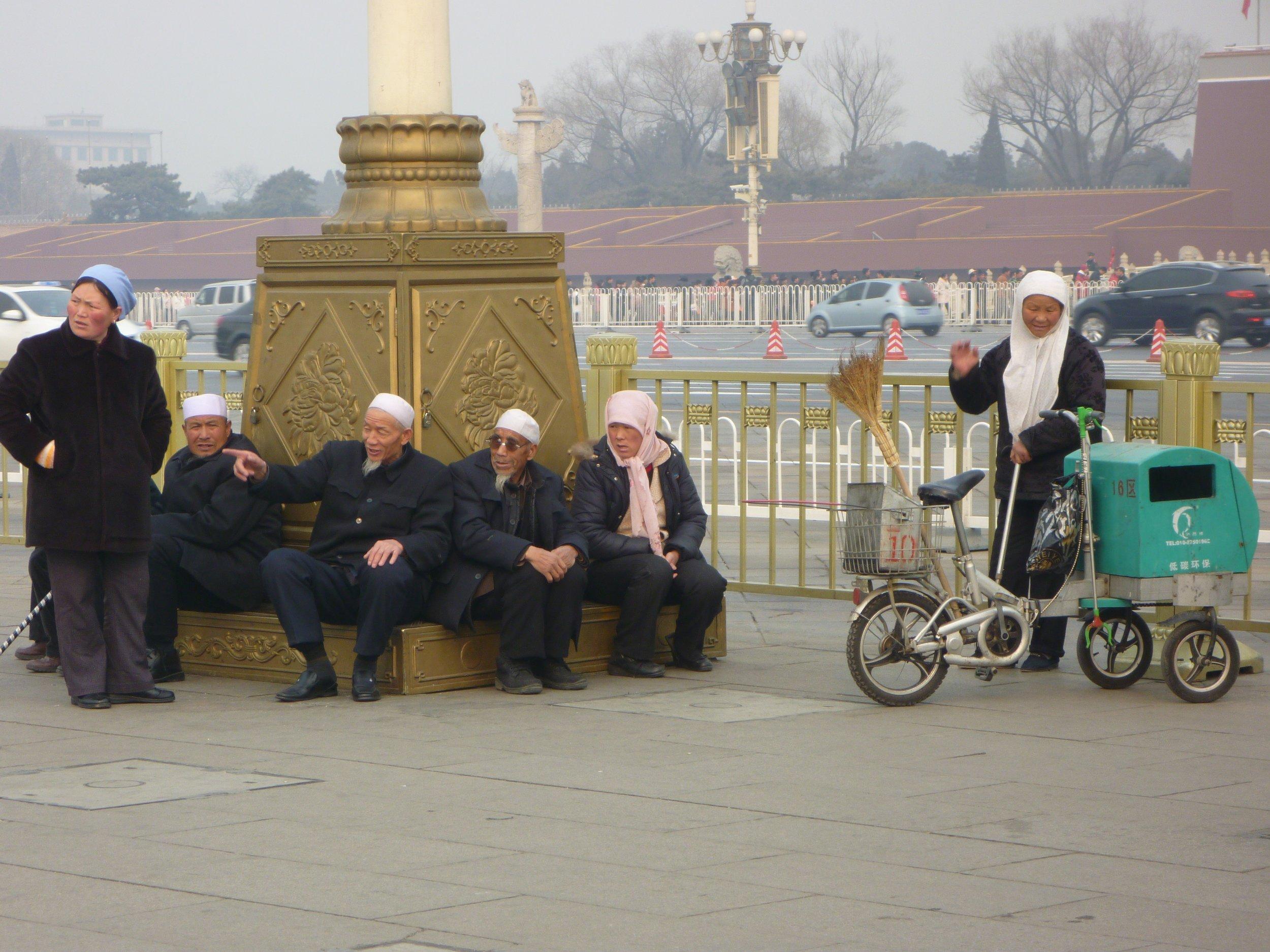 Uighur Minorities congregate in Tienanmen Square, Beijing.