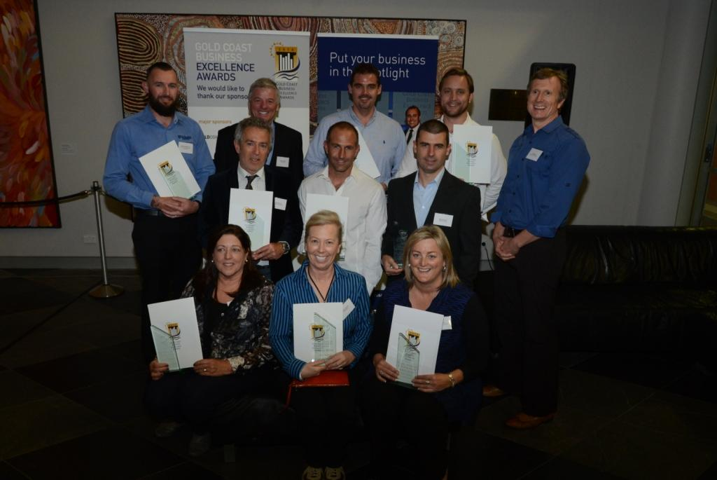 Andy & Janet posing with the other August 2014 Excellence Award winners