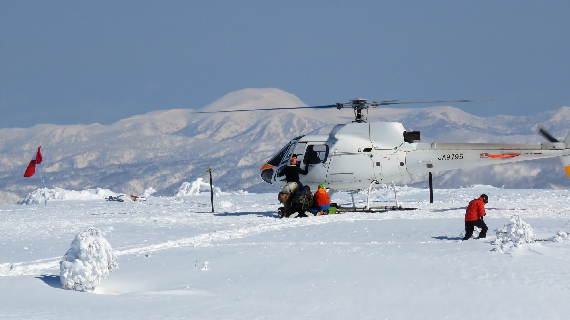 A crew being dropped off on top of the volcano