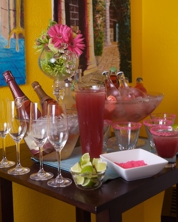 SOMETHING PINK DRINK BAR WITH COSMOS, SPARKLING ROSE, AND INDIVIDUAL BOTTLES OF ITALIAN SPARKLING SODA