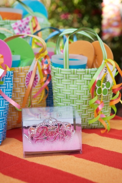 Hit up the dollar store for swag bag items your guests can use during the party and afterwards. Sunscreen, lotion, sunglasses, flip flops and more make great favors.