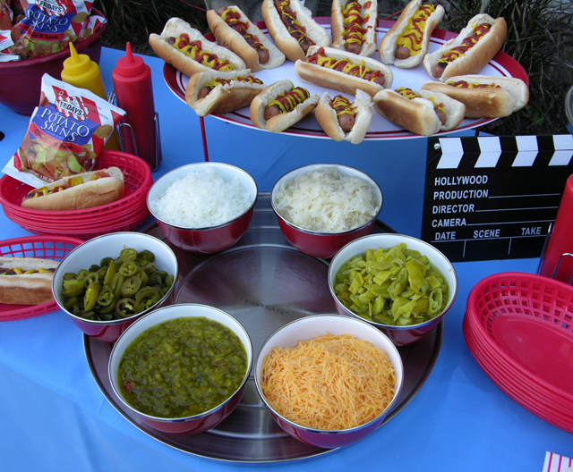 Create a topping bar for hot dogs so guests can make their own favorite style dog.