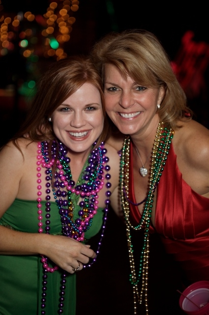 guests with beads at a Mardi Gras party Arden Photography