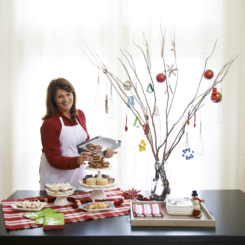 Easy party decorations include cookie cutters and small kitchen tools as tree decorations.
