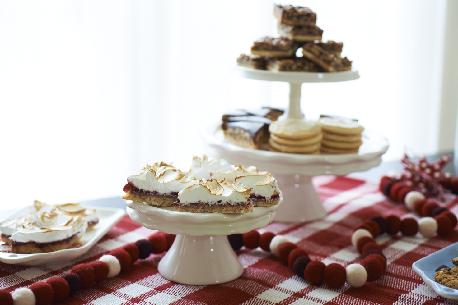 Set up a pretty buffet of cookies and candy plus coffee, hot tea, hot cocoa, and other holiday favorites.