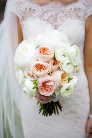 Soft pastels like blush and coral are showing up in bridal bouquets again; big blooms like these peonies are a showy way to express your style. PHOTO:  ARDEN PHOTOGRAPHY