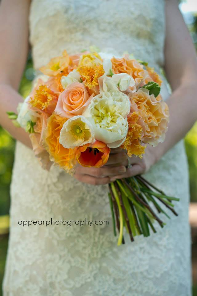 Apricot, cream, peach, and coral are the big colors of the moment. They look strikingly beautiful against a cream or ivory gown. My sweet friend Jenna's wedding flowers were by my other precious friend Corey Hults of  Corey Daniels Design for the Sonnet House in Leeds, Alabama. Stunning. (Photo: AppearPhotography.com)