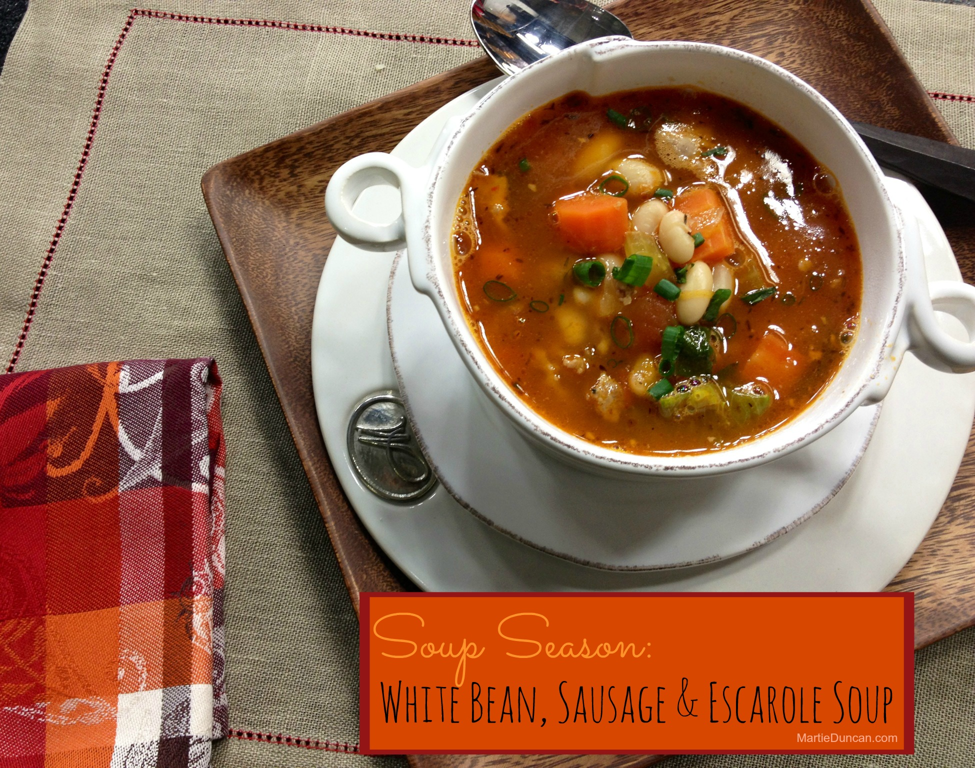 Sausage, White Bean, and Escarole Soup is hearty, easy, and very affordable for a big crowd! Serve with some toasted bread and a salad and you've got dinner!