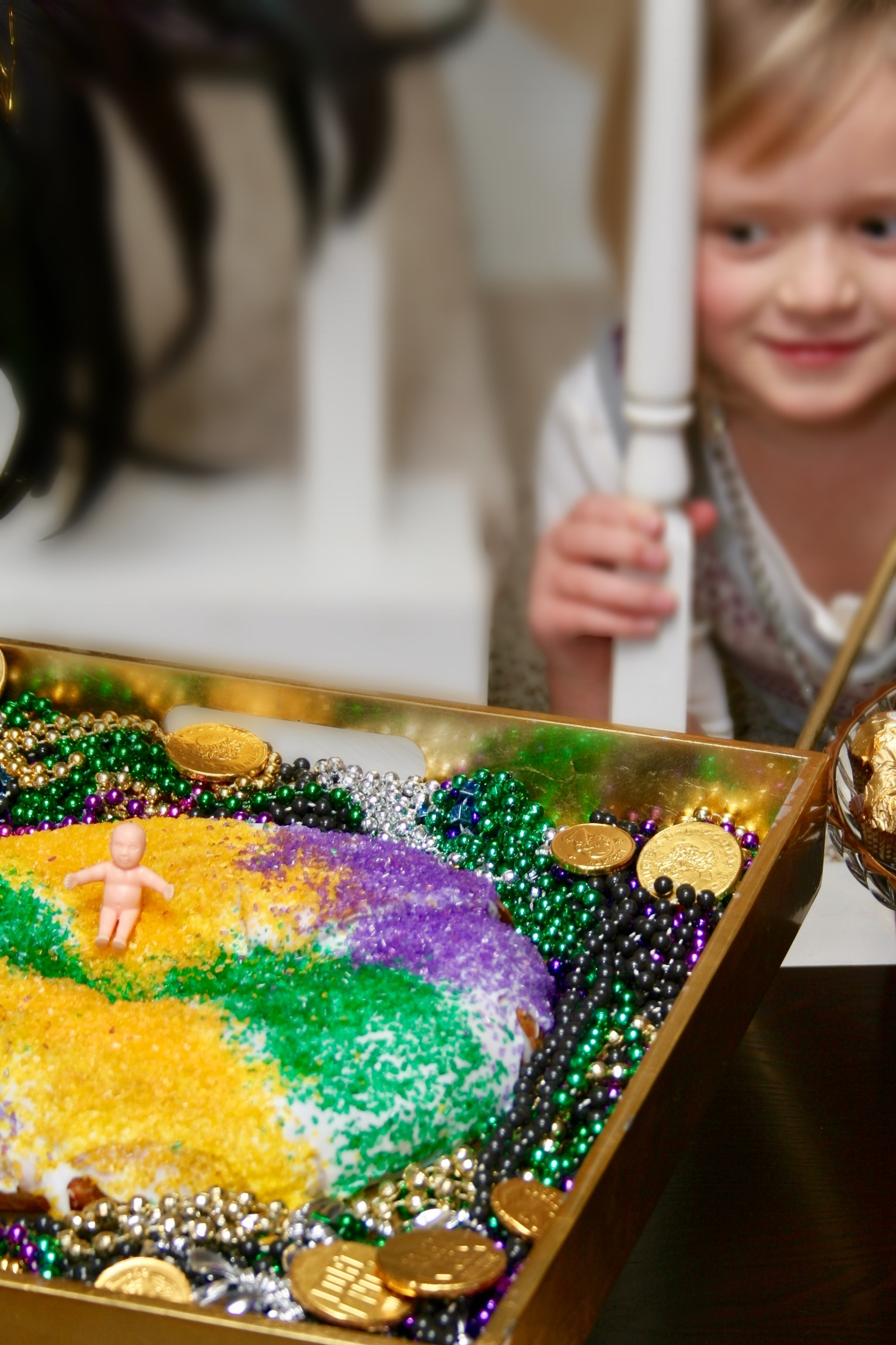why is there a baby in the King Cake?