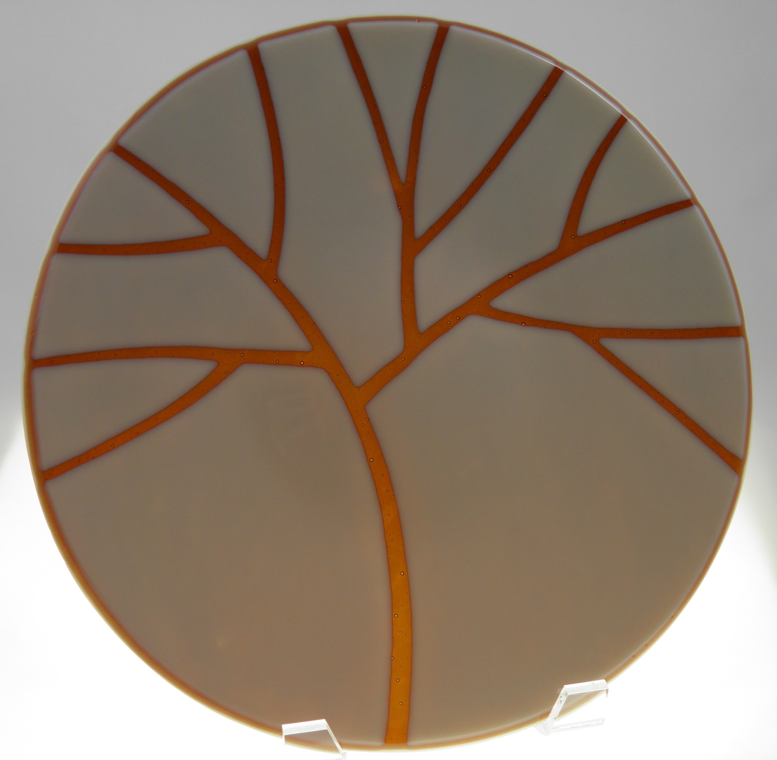 rust tree on cream platter