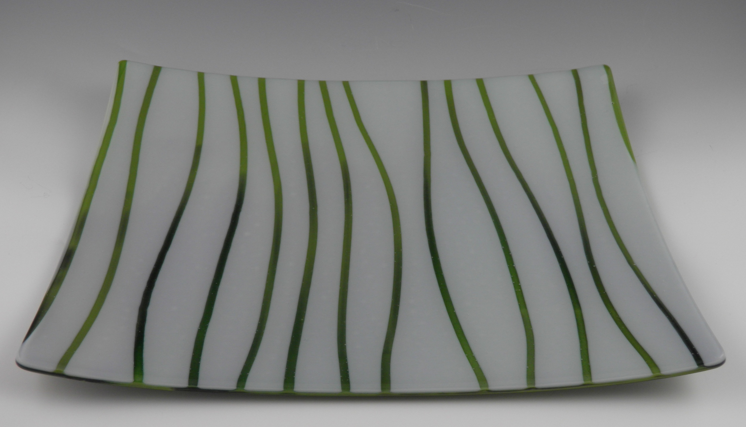green grass on white platter