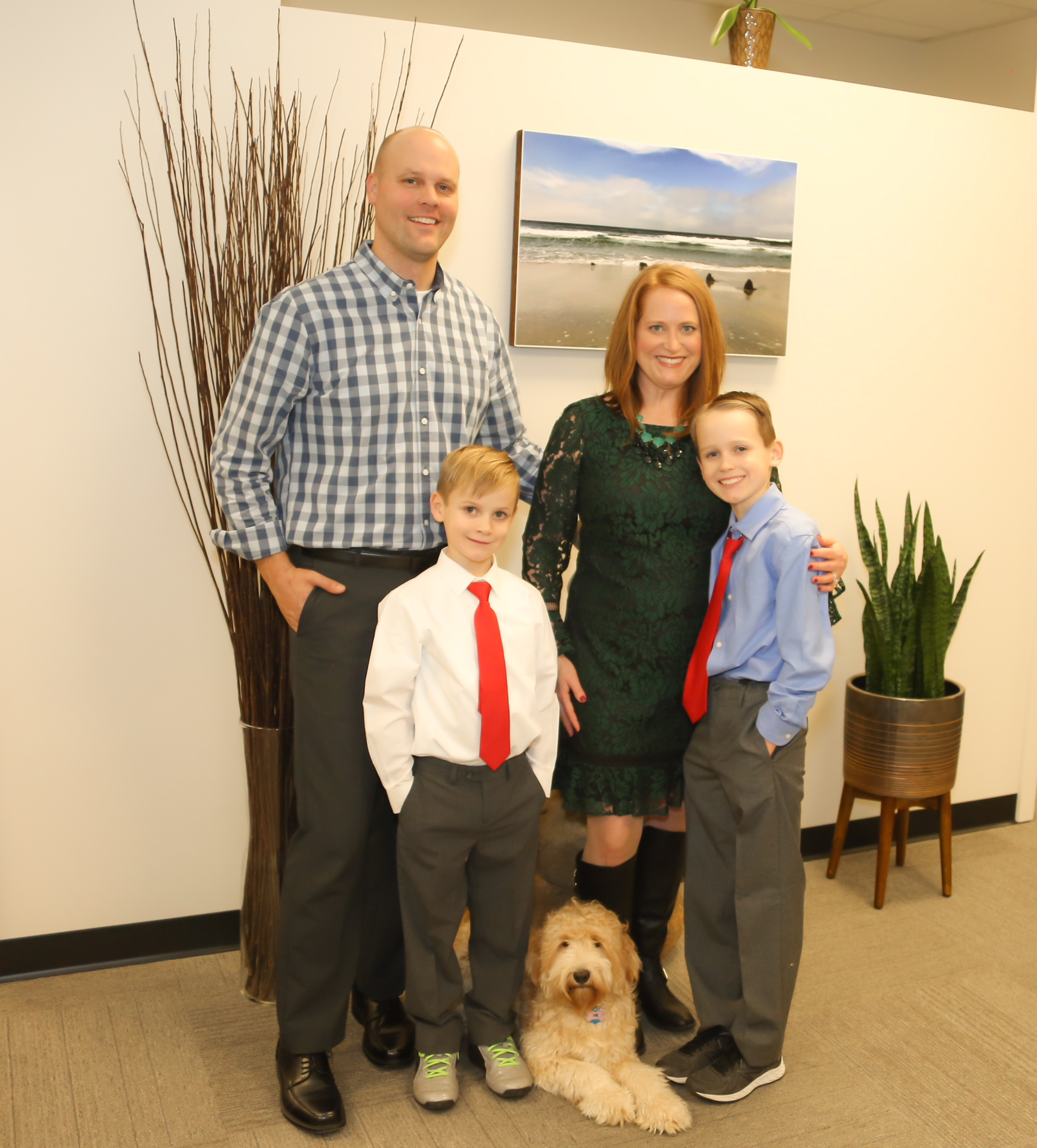 Dr. Ryan Schoeb with his wife, Molly, Connor, Cullen, and Goldendoodle Roxy