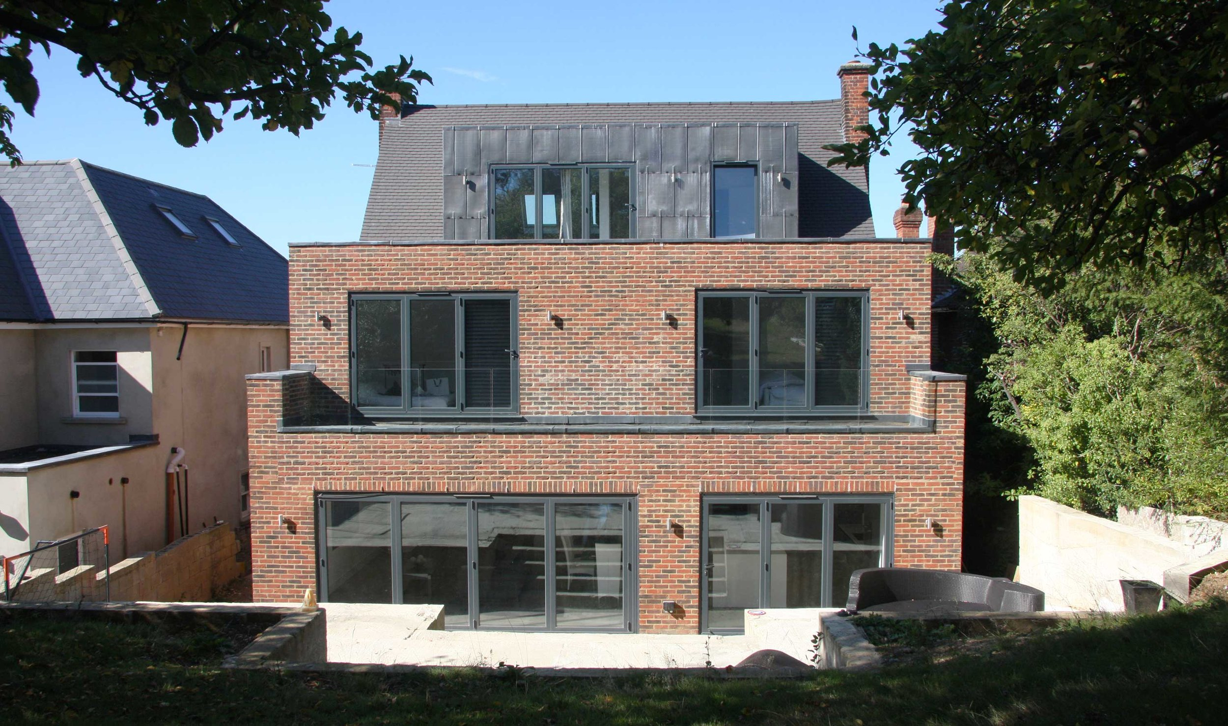 Extension, conversion and refurbishment of a detached house on Eleven Acre Rise in Loughton.