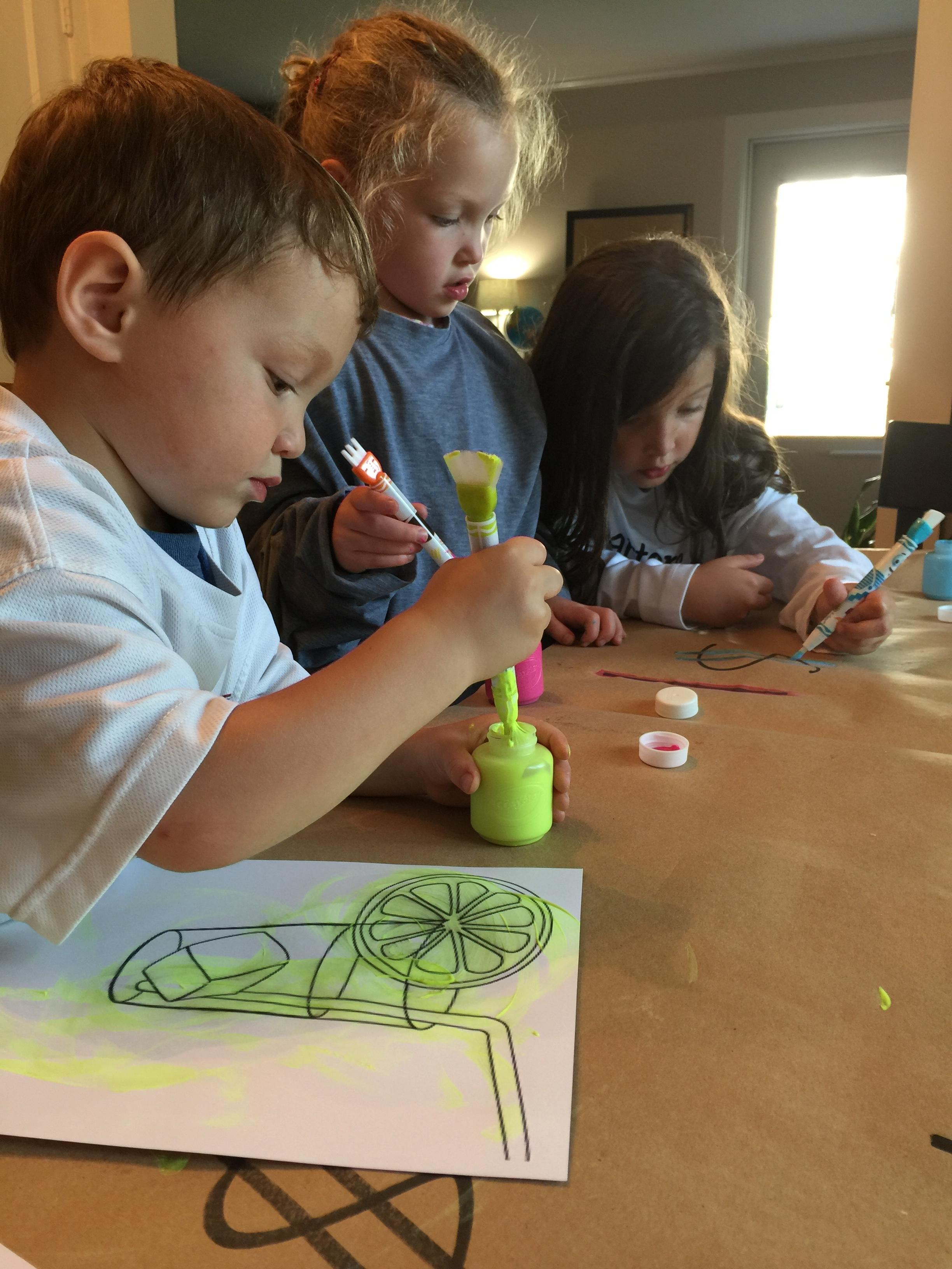 kids making sign for lemonade stand, Robin Camarote