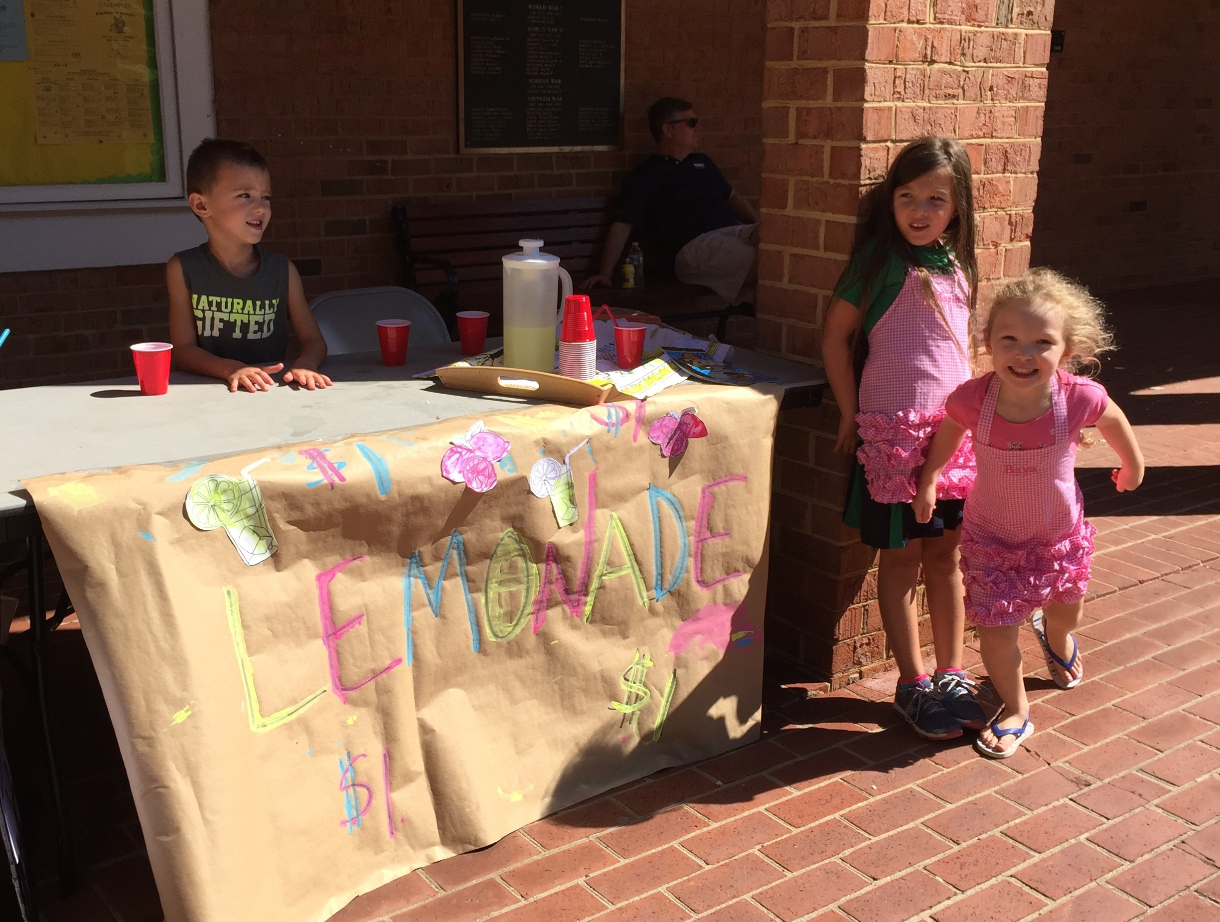 Baya, Marin, and our friend Nate selling lemonade.