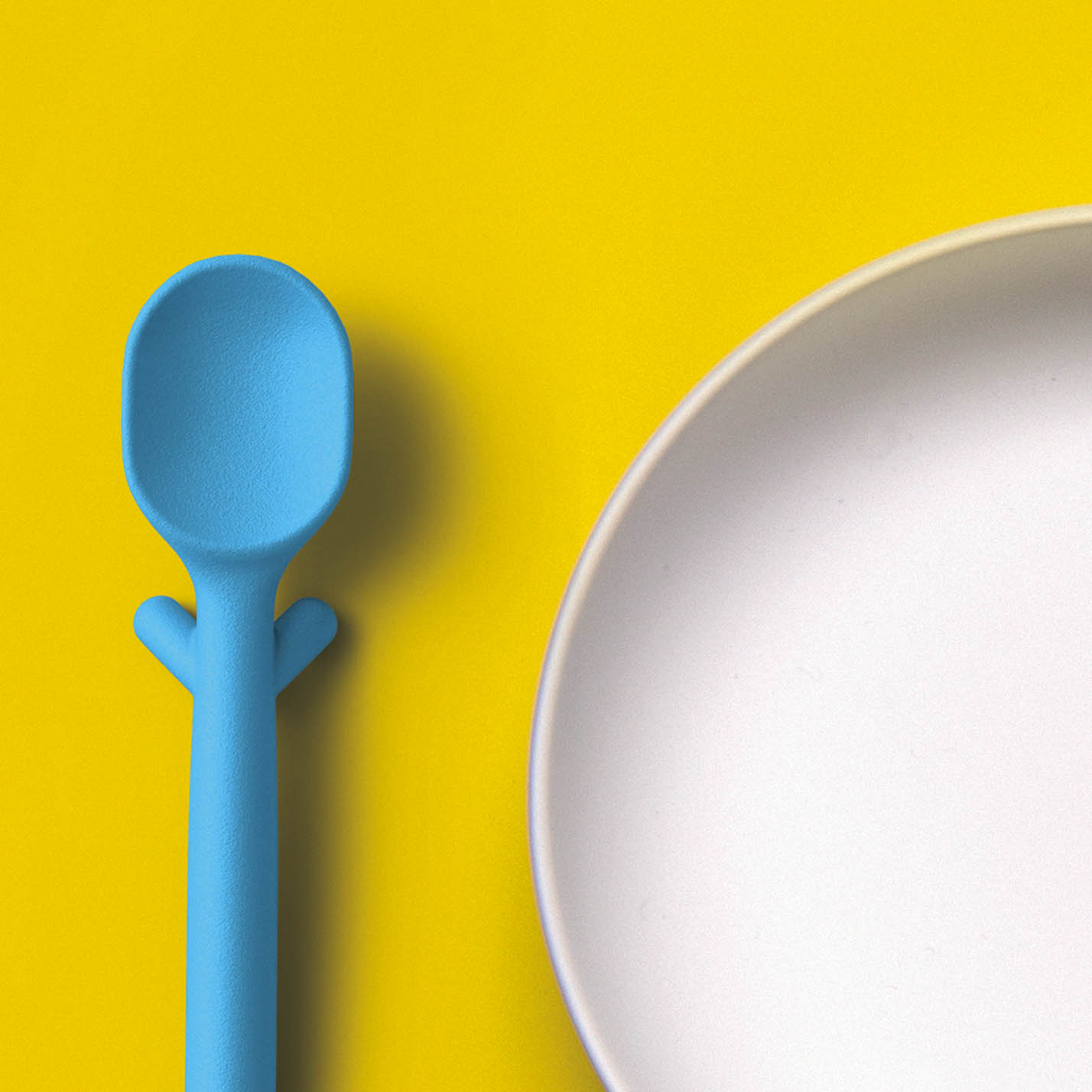 Nenu makes a very cool spoon with legs. Yes, legs. This not only keeps it elevated off dirty tabletops  but it helps elevate the spoon so little hands can pick it up.
