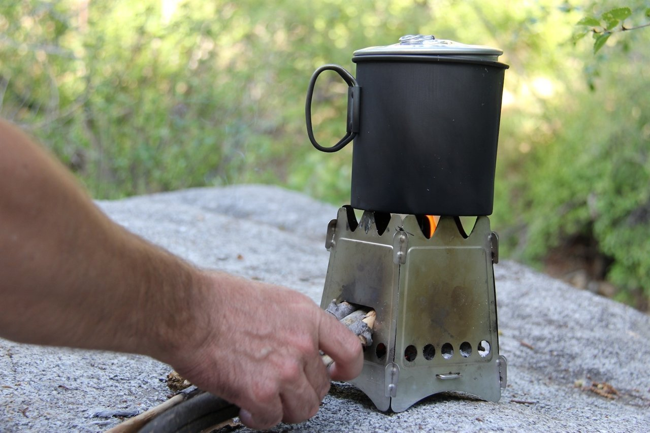 ULTRA LIGHTWEIGHT STOVES - Made in USA, Packs flat, Light Weight, Can be used together with multible products and Lifetime Warrenty, everything a camper needs.
