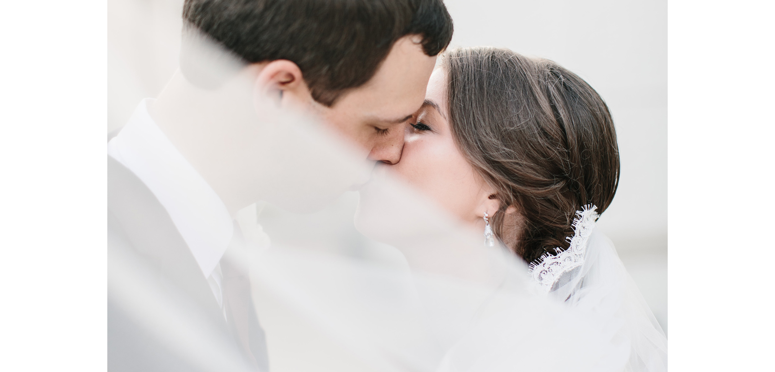 Wedding veil. wedding kiss. raleigh wedding photographer. raleigh photographer. wake forest photographer. wake forest wedding photographer.jpg