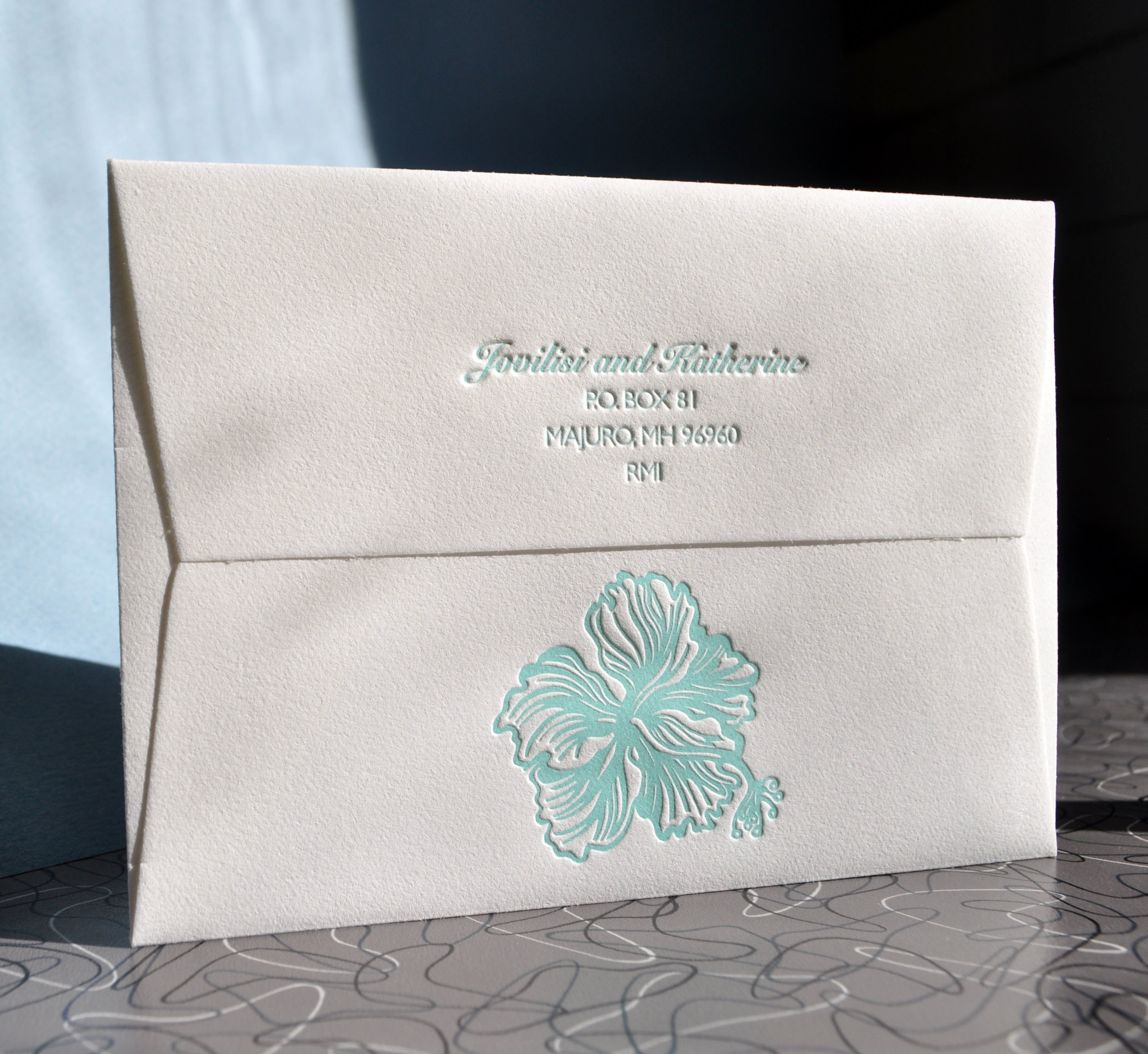Hibiscus envelopes for tropical destination suite