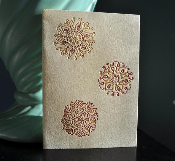 Gold, ruby Rangoli cards on Lettra Ecru